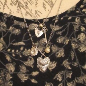 Jewelry - Multi layer silver charm necklace
